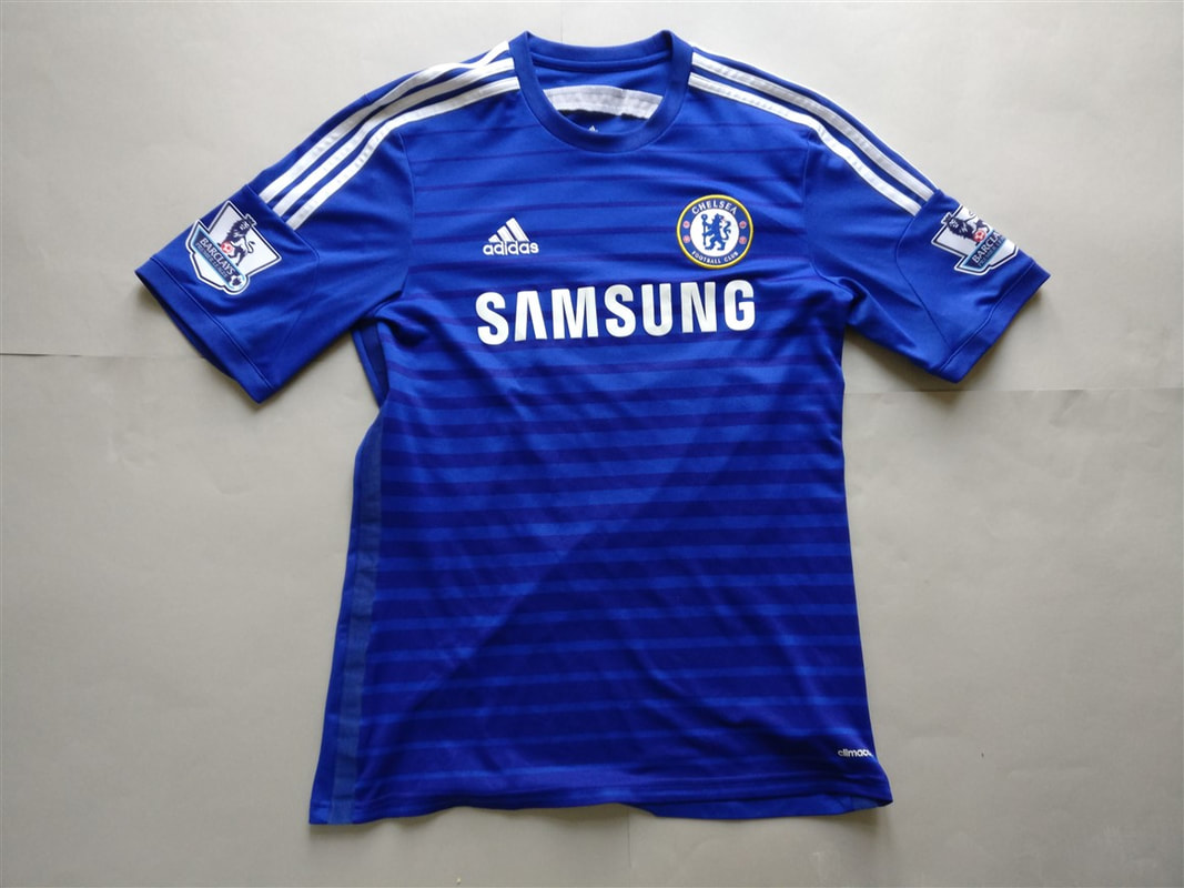 Chelsea F.C. Home 2014/2015 Football Shirt Manufactured By Adidas. The Shirt Is Sponsored By Samsung.