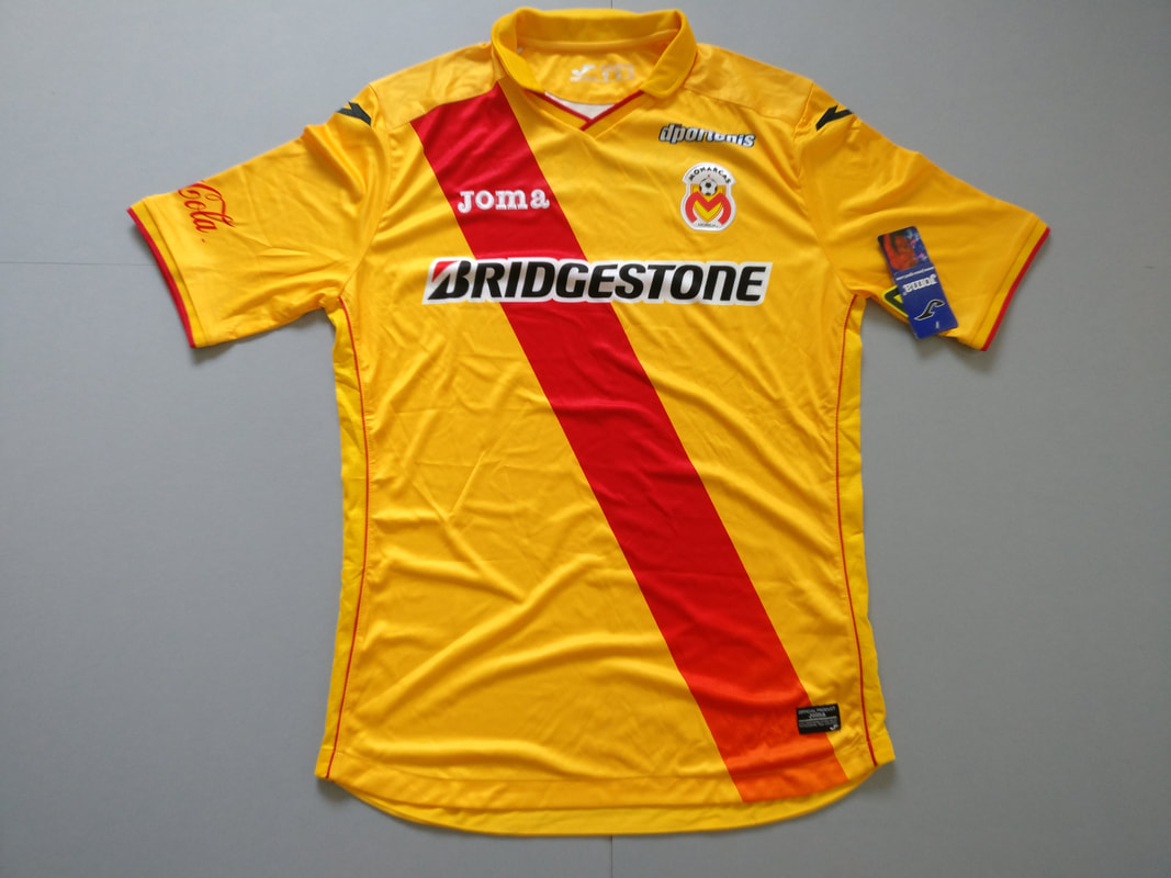 Club Atlético Monarcas Morelia Home 2014/2015 Football Shirt Manufactured By Joma. The Club Plays Football In Mexico.