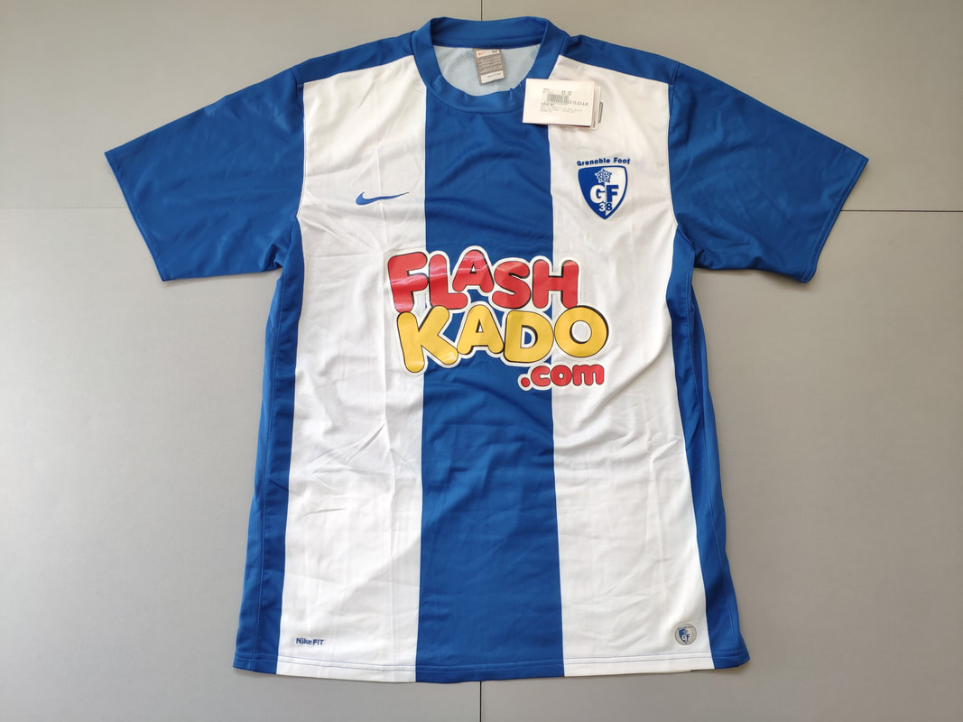 Grenoble Foot 38 Home 2009/2010 Football Shirt Manufactured By Nike. The Club Plays Football In France.