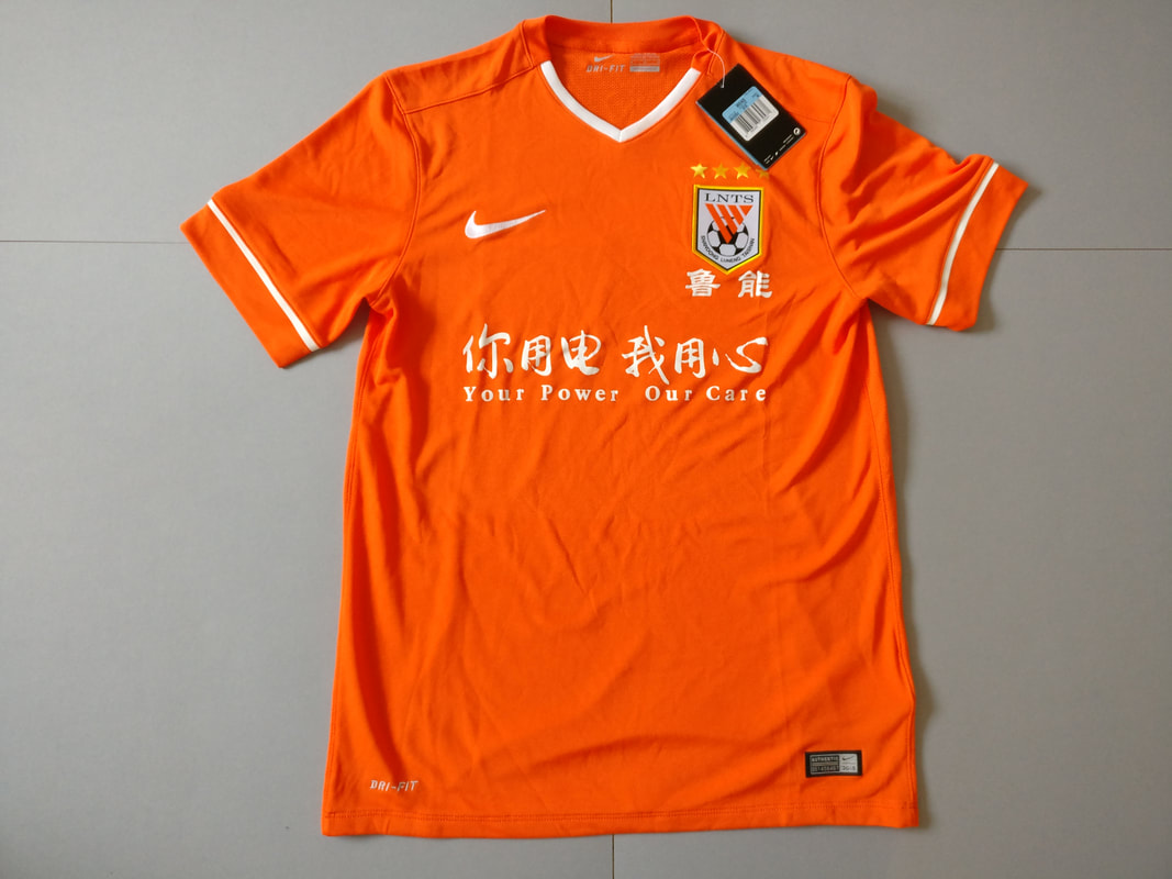 Shandong Luneng Taishan F.C. Home 2015 Football Shirt Manufactured By Nike. The Team Plays Football In Hong Kong.