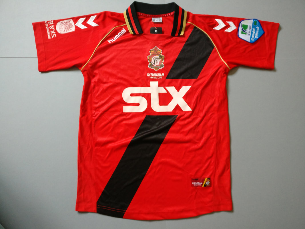 Gyeongnam FC Home 2012 Football Shirt Manufactured By Hummel. The Team Plays Football In South Korea.