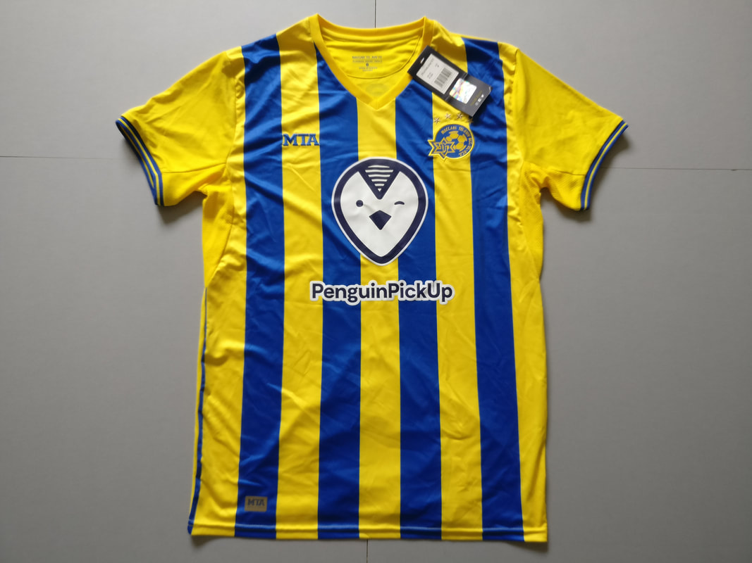 Maccabi Tel Aviv F.C. Home 2018/2019 Football Shirt Manufactured By MTA. The Club Plays Football In Israel.