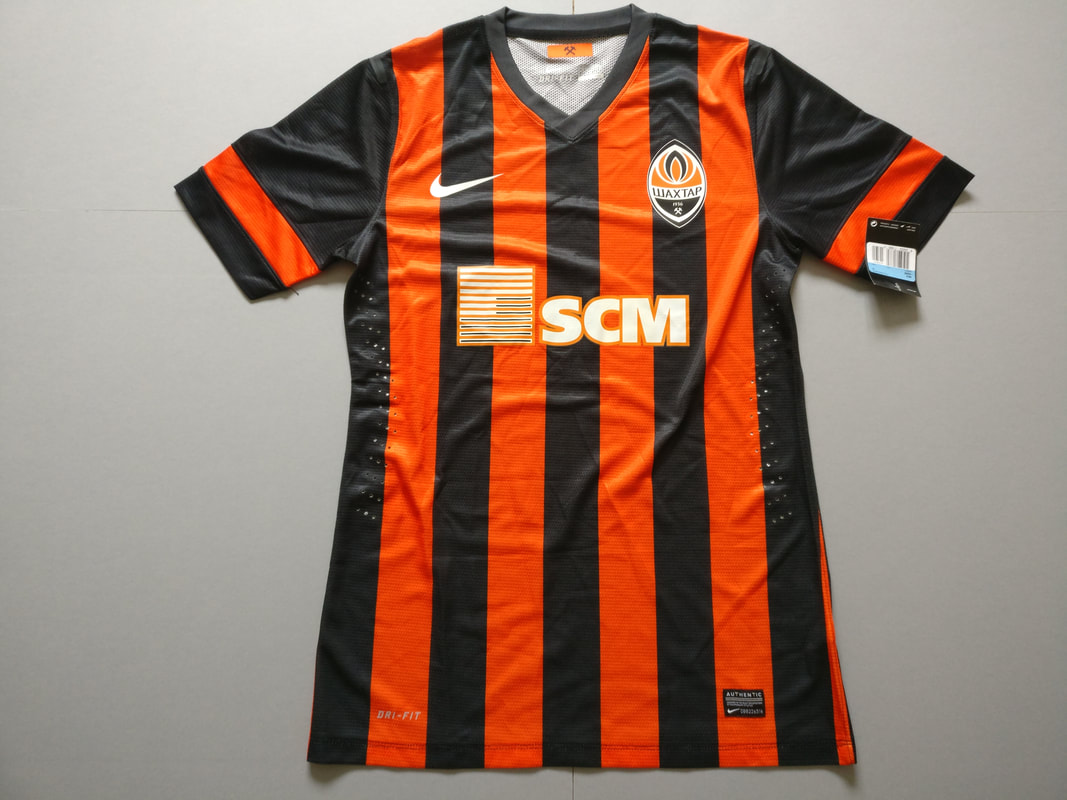 FC Shakhtar Donetsk Home 2013/2015 Football Shirt Manufactured By Nike. The Club Plays Football In Ukraine.