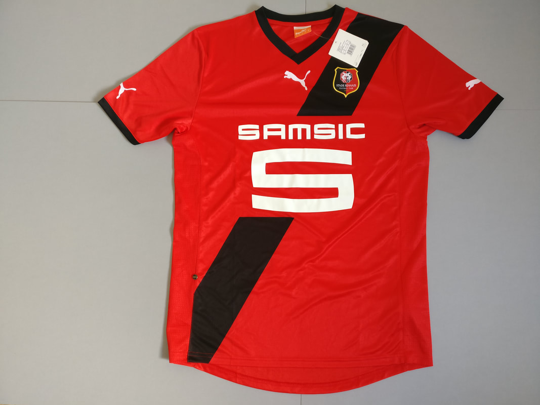 Stade Rennais F.C. Home 2011/2012 Football Shirt Manufactured By Puma. The Team Plays Football In France.